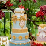 Opulent gold tiered wedding cake