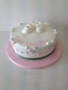 Sugar bootee christening cake