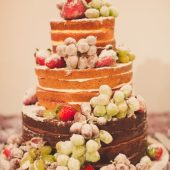 Three tiered indulgent party cake with fruit
