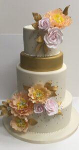 Gold and peony wedding cake