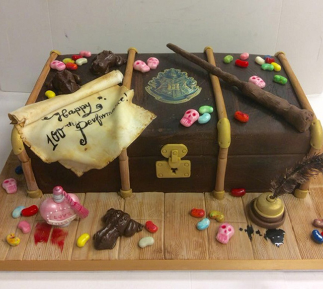 Harry Potter suitcase celebratory cake for JK Rowling