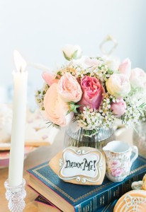 Books, candles and crockery go a logn way in the styling of an Alice in Wonderland event