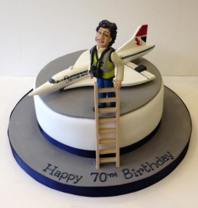 Concorde on a birthday cake with a sugar model of a woman