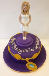 Model of a lady on a birthday cake