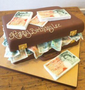 Money in suitcase birthday cake