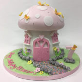 Mushroom house themed birthday cake