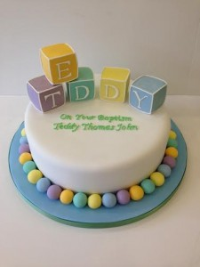 Christening cake in pastel colours