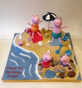 Peppa and family and the beach birthday cake