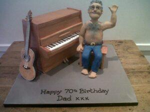 Man playing the piano birthday cake
