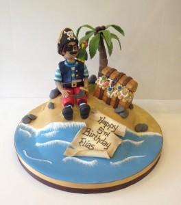 Pirate on a dessert island birthday cake