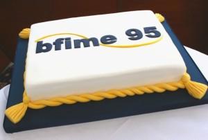 Company logo anniversary cakes