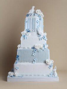 Blue birdcage wedding cake