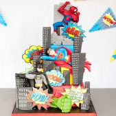 Tiered cake with examples of models and building silhouettes