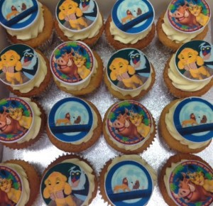 Edible sugar discs printed with images using edible ink on top of swirled buttercream cakes