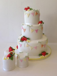 Strawberry and bunting wedding cake
