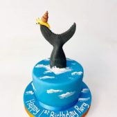 Whale tail themed 1st birthday cake