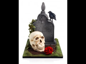 Halloween skull and tombstone cake