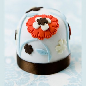 Miniature brown and red flower cake