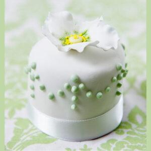 Miniature white and green flower wedding cake