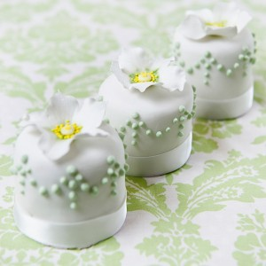 Miniature white and green flower wedding cakes