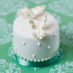 Miniature white and green butterfly wedding cake