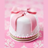 miniature white and pink ribbon wedding cake