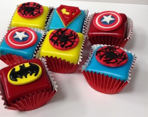 Superhero fondant fancies dessert table