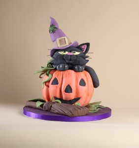 pumpkin and witch's cat cake