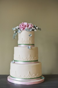 Eucalyptus and rose tiered wedding cake