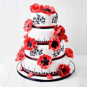 Red and black flowers wedding cake