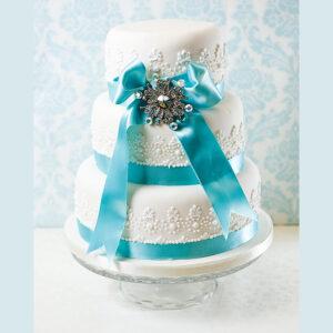 White with blue ribbon wedding cake